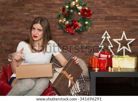 Pretty woman opening a gift box for Christmas - stock photo