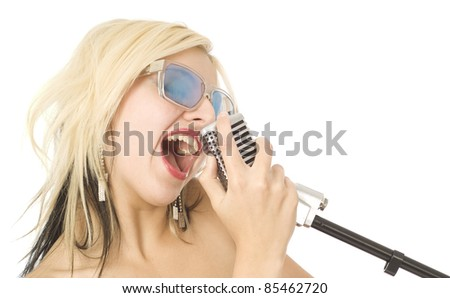 Pretty woman or girl music singer with microphone and sunglasses on white - stock photo