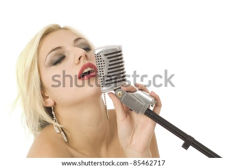 Pretty woman or girl music singer with microphone on white - stock photo