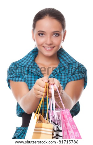 Pretty woman passes bags for shopping. Only bags for shopping in focus - stock photo