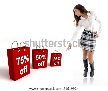 pretty woman pointing at the  three dimensional shopping bags against white background - stock photo