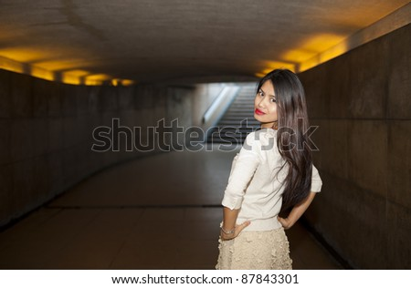 pretty woman posing in the subway area of paris - stock photo