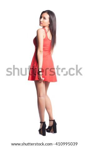 pretty woman posing wearing a red dress - stock photo