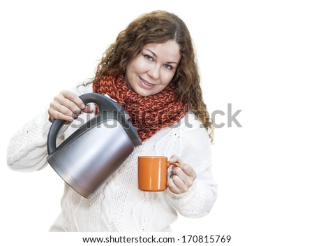 Pretty woman pouring hot water from the kettle into a cup, isolated on white background - stock photo