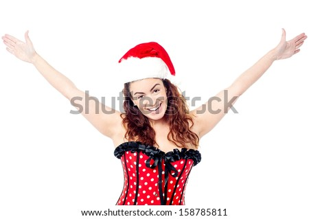 Pretty woman raising her arms in excitement - stock photo