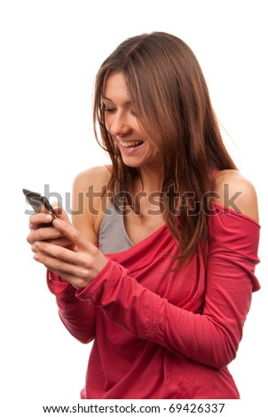 Pretty woman reading, typing and sending SMS text message on mobile cellphone smiling and laughing isolated on a white background - stock photo