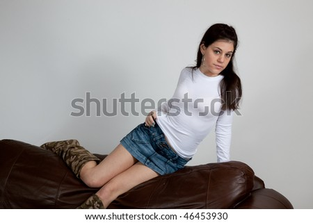 Pretty woman recling on a couch