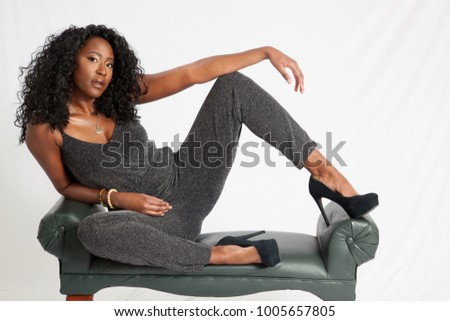 Pretty woman reclining thoughtfully on a bench