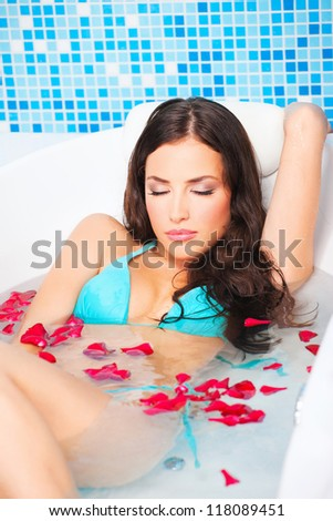 Pretty woman relaxing in jacuzzi - stock photo