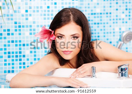 Pretty woman relaxing in spa center - stock photo