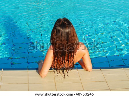 pretty woman relaxing in the pool
