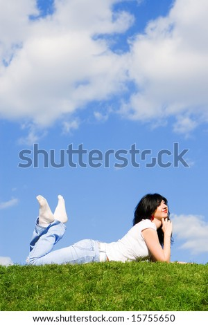 pretty woman rest on the green grass