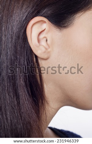 Pretty woman's ear close up - stock photo