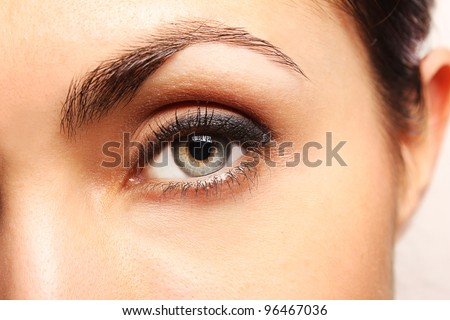 Pretty woman's eye close up - stock photo