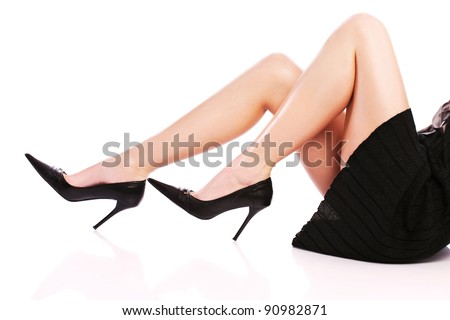 Pretty woman's legs and high heels - stock photo