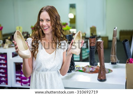 Pretty woman shopping for shoes at the shopping mall