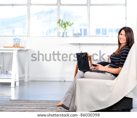 Pretty woman shopping online from the comforts of her home - stock photo