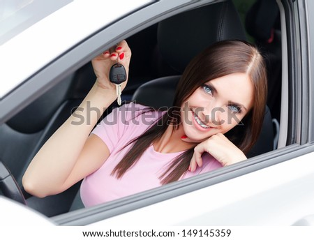 Pretty woman showing the car key  - stock photo