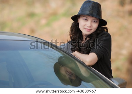Pretty woman side by a car
