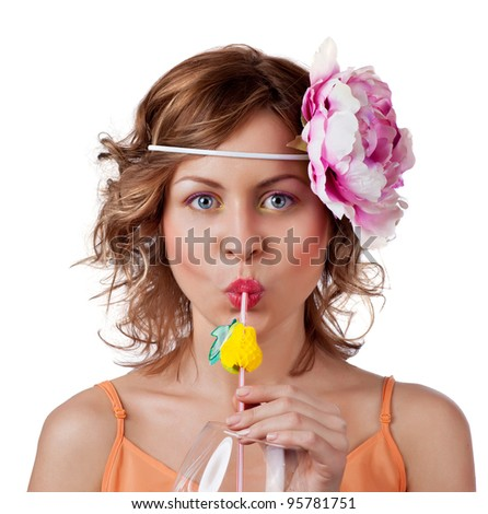 Pretty woman sipping orange juice - stock photo