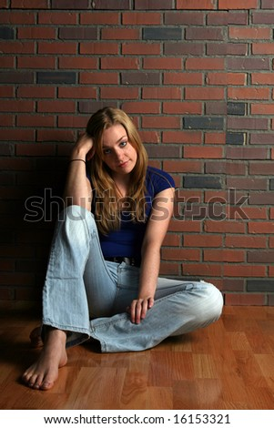 pretty woman sitting - stock photo