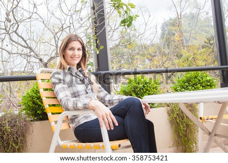 Pretty woman sitting in a green place