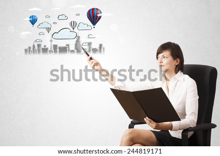 Pretty woman sketching cityscape with colorful balloons and clouds - stock photo