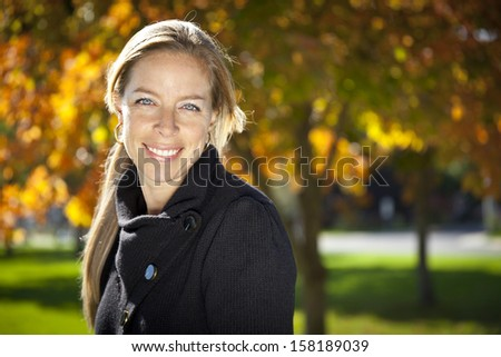 Pretty Woman Smiling At The Camera In Nature - stock photo