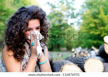 Pretty woman sneeze. Allergy season - stock photo