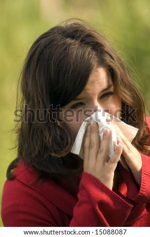 Pretty woman sneeze. Allergy season - stock photo