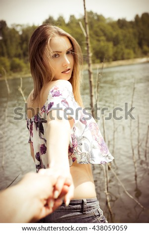 pretty woman standing in front of a lake / Summer