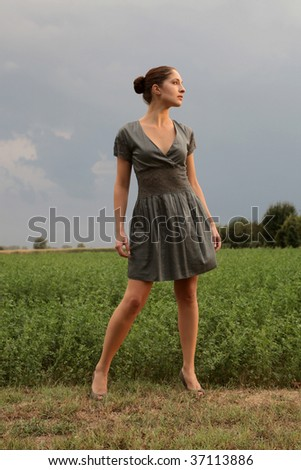 pretty woman standing in the nature - stock photo