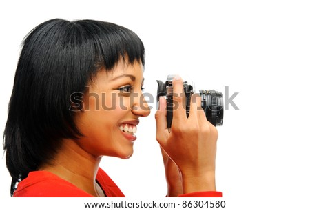 Pretty woman takes a picture with a vintage SLR camera - stock photo