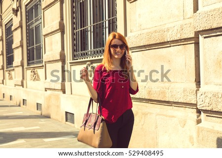 Pretty woman using cellphone outdoors.