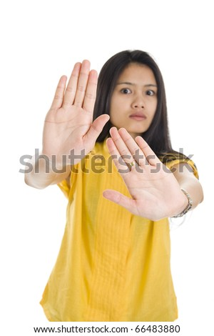 pretty woman wants somebody to stop doing something, isolated on white background with a shallow depth of field on the palms. - stock photo