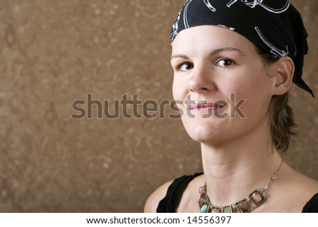 Pretty Woman Wearing a Bandanna on Her Head - stock photo