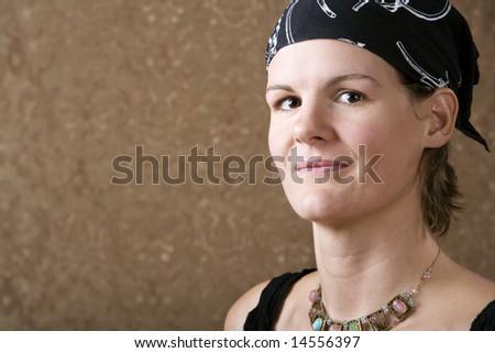 Pretty Woman Wearing a Bandanna on Her Head - stock photo