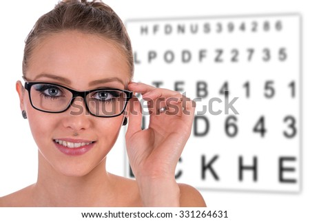 pretty woman wearing glasses / Eye Test - stock photo