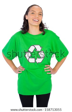 Pretty woman wearing green recycling tshirt against white background - stock photo