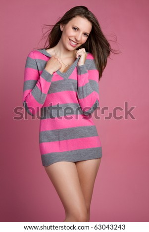 Pretty woman wearing pink sweater - stock photo