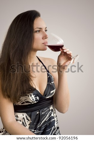 Pretty woman with a glass of red wine - stock photo