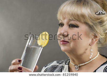 Pretty Woman with a glass of water - stock photo