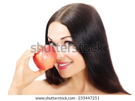 Pretty woman with a red apple, white background, isolated - stock photo