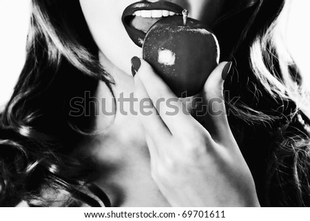 Pretty woman with an apple - stock photo