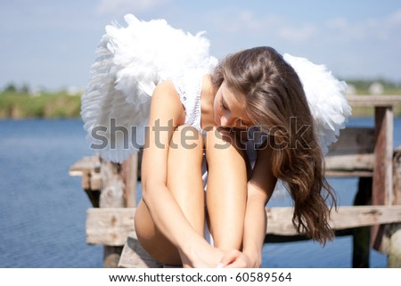 Pretty woman with angel wings