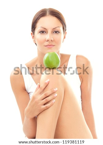Pretty woman with apple, isolated on white - stock photo