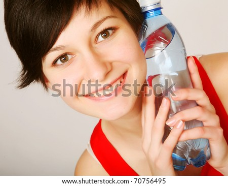 pretty woman with bottle of clean water - stock photo