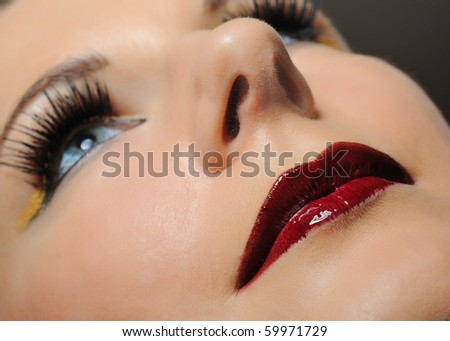 pretty woman with bright make-up and violet lipstick - stock photo