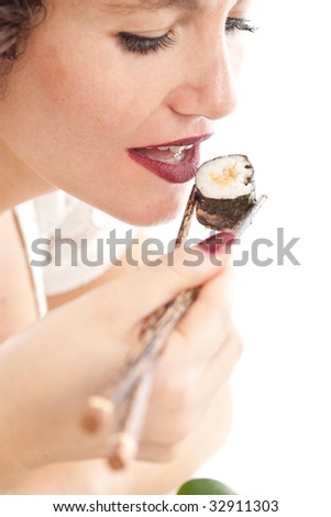 Pretty woman with cherry colored lips eating sushi (focus on lips) - stock photo