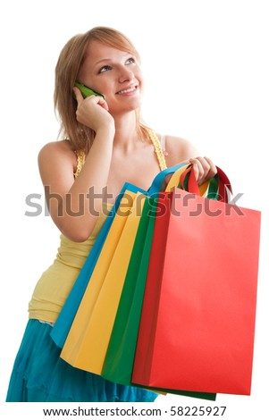 Pretty woman with colorful bags smiling and talking